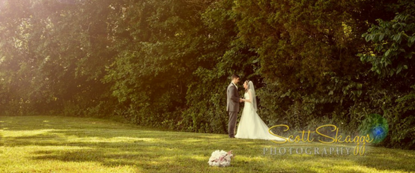 Photo of a bride and groom with a lovely landscape