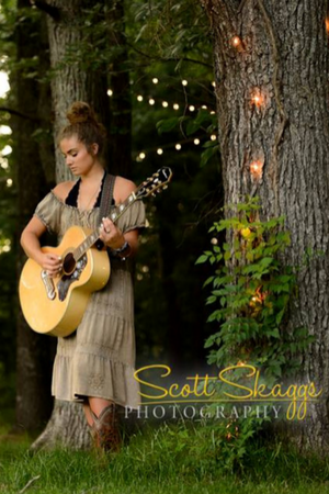 Senior photo shoot of a girl hold a guitar