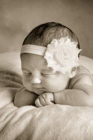 Photo of a baby on a white blanket