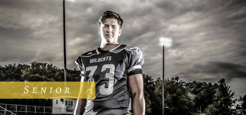 Senior pictures of a football player on the field